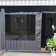 Drop blind with zip door and clear pvc window
