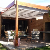 Meranti Structure with its retractable pergola awning custom designed to fit round the braai. Installation Durbanville